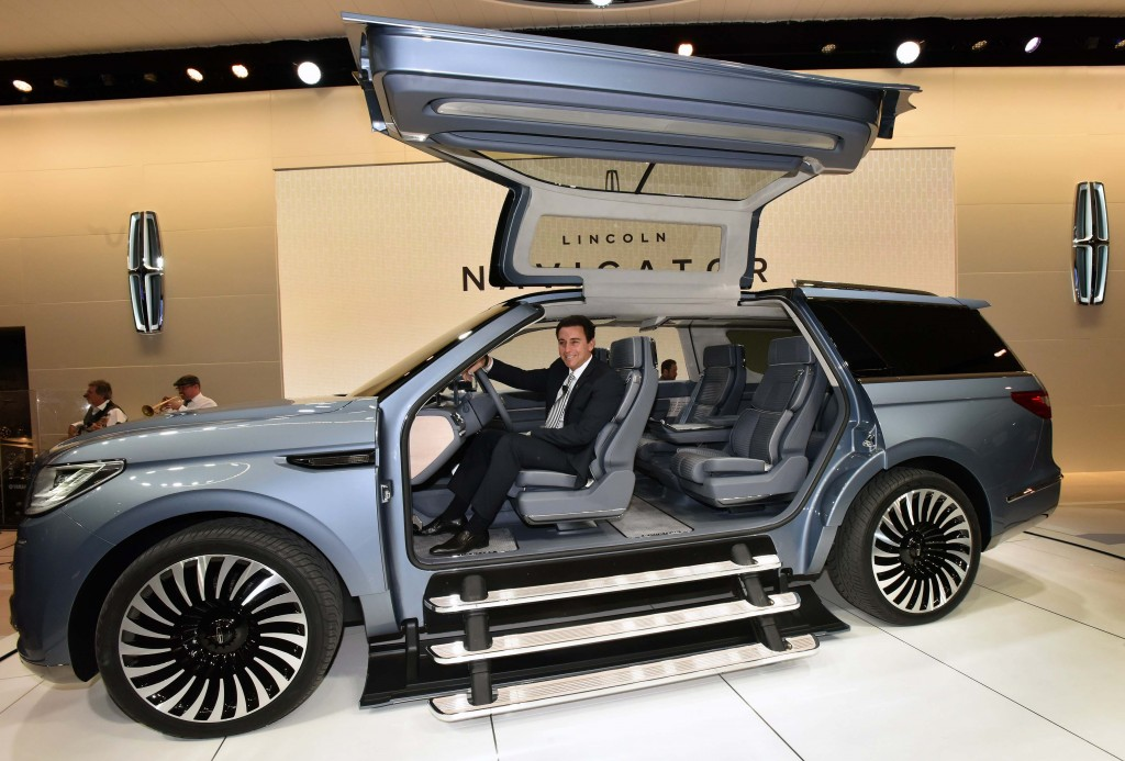 """NEW YORK, March 23, 2016 -- €""""Mark Fields, President and CEO, Ford Motor Co. reveals the Navigator Concept, introducing quiet luxury to full-size SUVs and offering a glimpse at what comes next for the brand's best-known nameplate. Lincoln invented the large luxury SUV in 1997, and now is reimagining Navigator for modern clients interested in better performance, more space and further refinement.  Lincoln'€™s design team drew inspiration from luxury sailboats and yachts when designing the new concept. This influenced everything from the clean, modern lines and Storm Blue paint on the exterior that mimics the grays and blues of sea and sky, to the teak finishes, custom gear and wardrobe management system found inside. The Navigator Concept is engineered to provide drivers peace of mind. It features a 3.5-liter twin-turbo V6 engine delivering more than 400 horsepower and smart new technologies to make this SUV even more sure-footed on different road surfaces and in changing weather conditions.  Photo by: Sam VarnHagen"""
