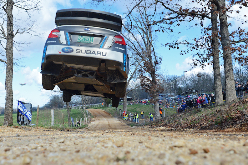 SRTUSA_driver_David_Higgins_soars_over_a_jump_at_Rally_in_the_100_Acre_Wood._