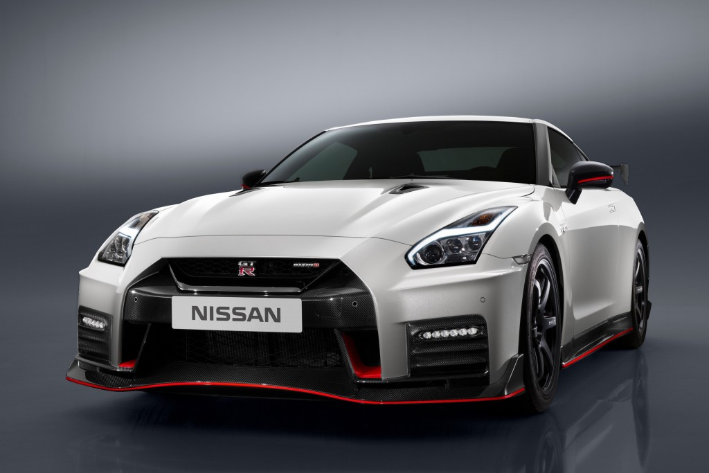 """The 2017 Nissan GT-R NISMO's front end features a freshened face highlighted by an aggressive new fascia. To help cool the car's high-output engine, the dark chrome """"V-motion"""" grille has been enlarged to collect more air, without diminishing the car's aerodynamic performance. A new significantly reinforced hood avoids deformation at extremely high speeds, allowing it to keep its aerodynamic shape. Unlike the standard model, the front bumper of the GT-R NISMO – crafted with Takumi-like precision – feature layers of carbon-fiber sheets carefully overlapped to achieve the ideal amount of stiffness."""